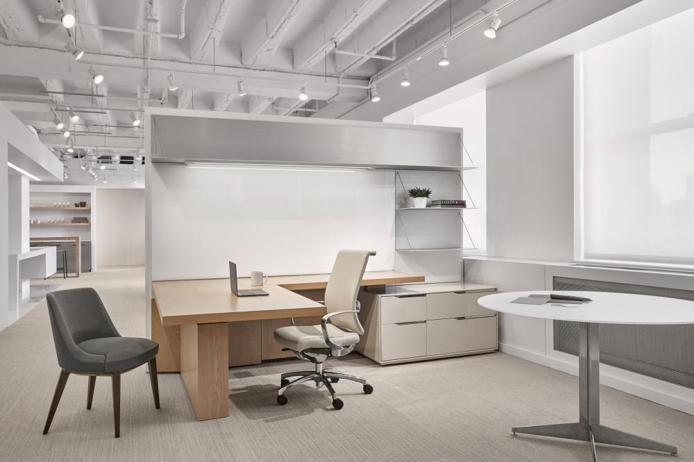 Preview of Ascari | Casegood | Development Finish on Oak | WG White Gloss Glass Back Panel | Clear Anodized Aluminum Shelves | L Shape Desk | Chicago Showroom