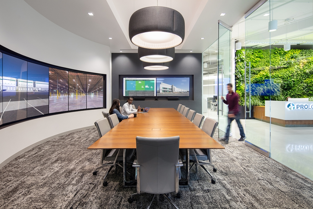 Preview of Flow | Conference Table | Rectangle Veneer Top | Polished Chrome Hoop Base | Prologis | Photography: Davies Imaging Group LLC.