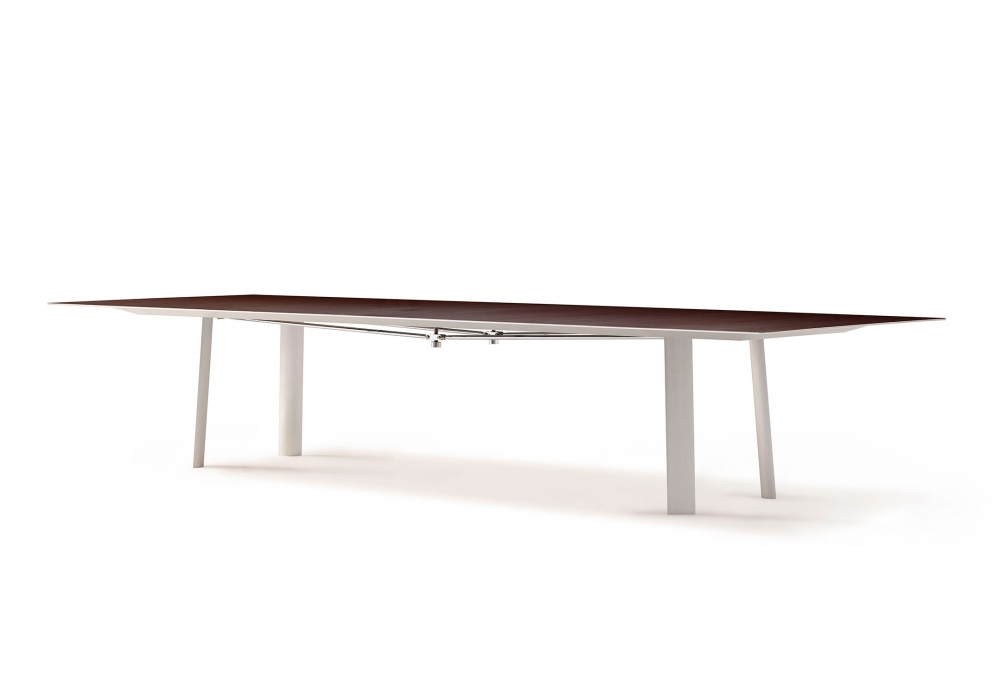 Preview of Kai | Conference Table | M26 Walnut Veneer Top | Clear Anodized Metal Legs | Polished Chrome Camber Rail | Angled View
