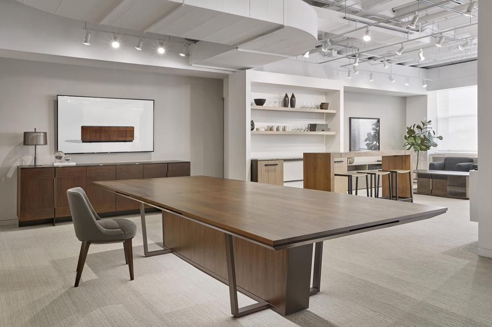 Preview of Crossbeam | Conference Table | Custom Finish on Planked Walnut Planked Veneer Top | A8010 Aged Bronze Base | Custom Finish on Walnut Veneer Center Base Panels | Chicago Showroom