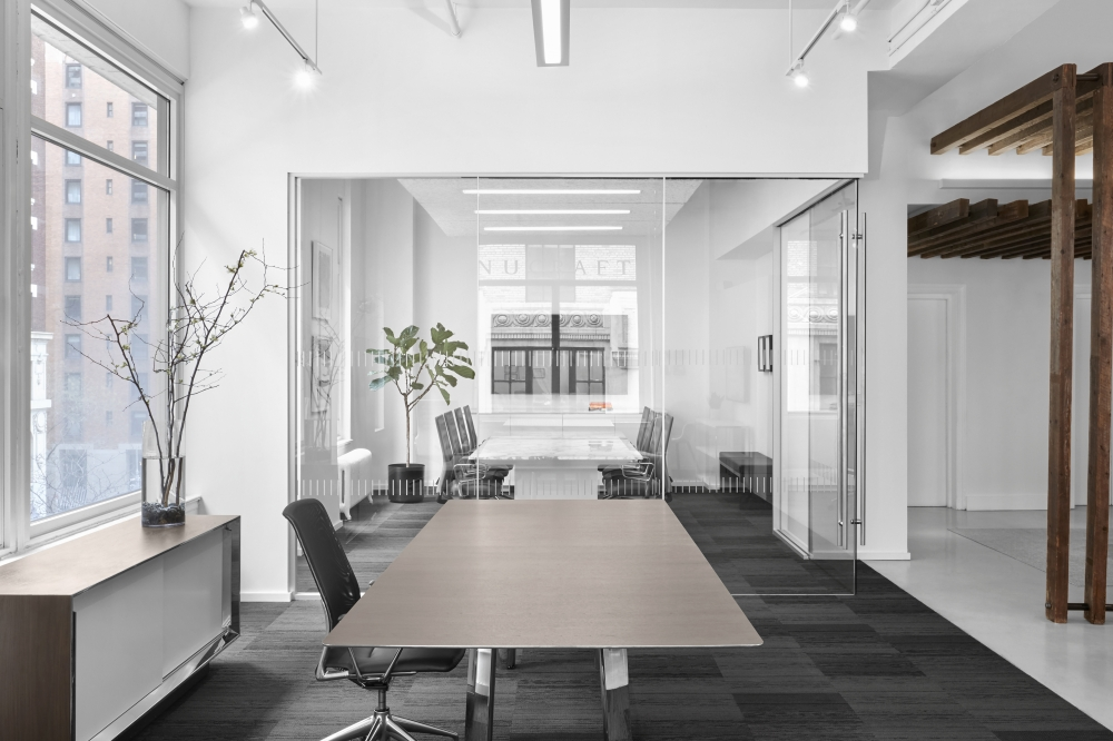 Preview of Kai | Conference Table | M27 Walnut Linea Veneer Top | Polished Chrome Legs | Side View | New York Showroom