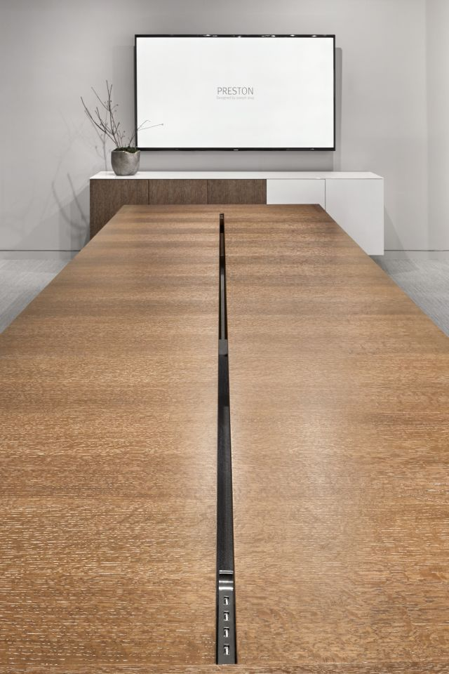 Preston | Community Table | Flaky Oak | Center Channel | Satin Bronze Plating | Chicago Showroom