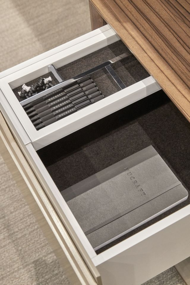 Ascari | Casegood | Canyon Paldao Veneer | Burnished Painted Door Fronts | Drawer Detail | Chicago Showroom