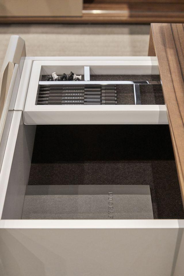 Ascari | Casegood | Development Finish on Paldao Veneer | Burnished Painted Door Fronts | Drawer Detail 4 | Chicago Showroom