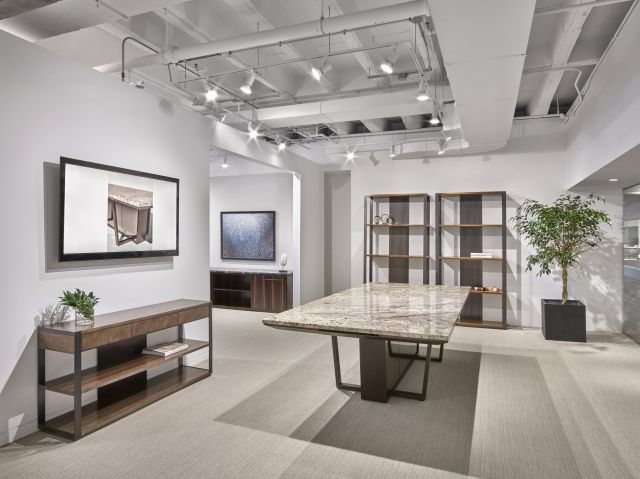 Crossbeam | Conference Table | COM Stone Top | Aged Bronze Base | Bronze Mirrored Acrylic Panels | Chicago Showroom