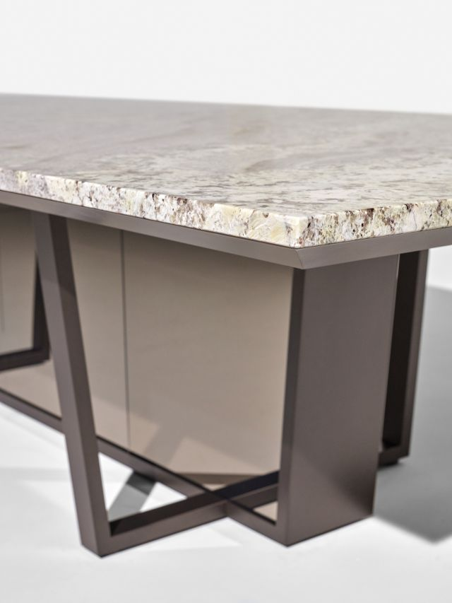 Crossbeam | Conference Table | COM Stone | Aged Bronze Base | Bronze Mirrored Acrylic | Side View Detail