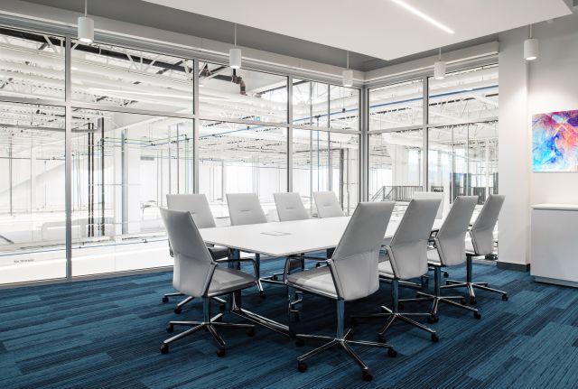 Flow | Conference Table | Polished Chrome Hoop Base | Dorigo Systems | Photo: Larry Goldstein