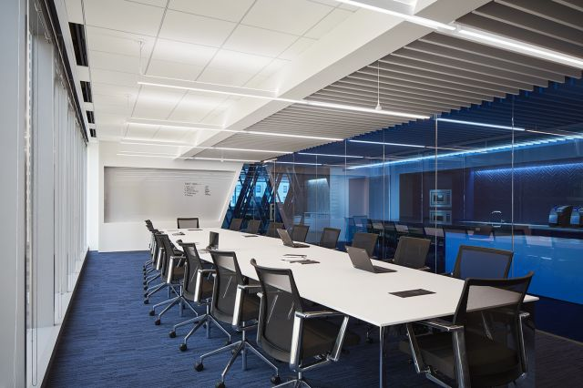 Flow   Conference Table   Boat Shaped Bright White Laminate Top   Chrome Four Post Base   CNA Headquarters   Photography: Tom Harris