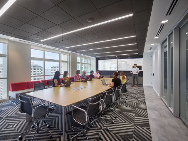 Flow Conference Table | M49 Ash Veneer Top | Four Post Base | Mastercard Miami Photo: Halkin Mason Photography Designer: Gensler