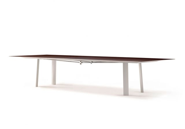 Kai | Conference Table | M26 Walnut Veneer Top | Clear Anodized Metal Legs | Polished Chrome Camber Rail | Angled View