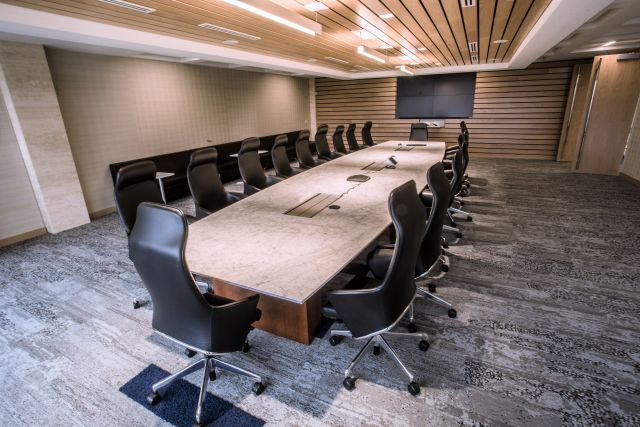 Flow | Conference Table | Boat Shape Stone Top | Veneer Rectangle Base | Corporate Design Interiors