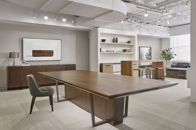 Crossbeam | Conference Table | Custom Finish on Planked Walnut Planked Veneer Top | A8010 Aged Bronze Base | Custom Finish on Walnut Veneer Center Base Panels | Chicago Showroom