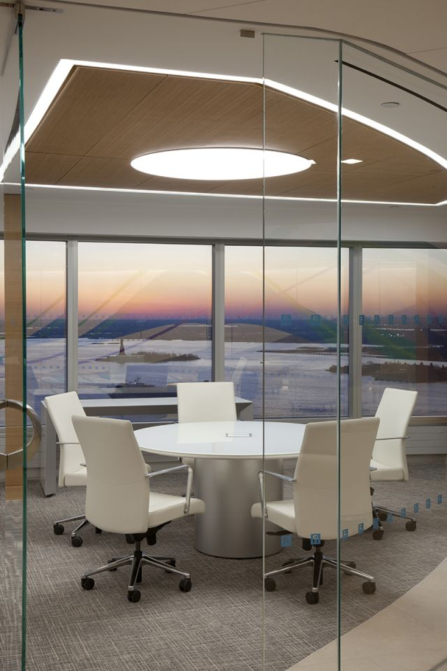Flow | Meeting Table | Round White Glass Top | Foil Paint Cylinder Base | Power Matrix | Fidessa | © Peter Mauss/Esto, Huntsman Architectural Group
